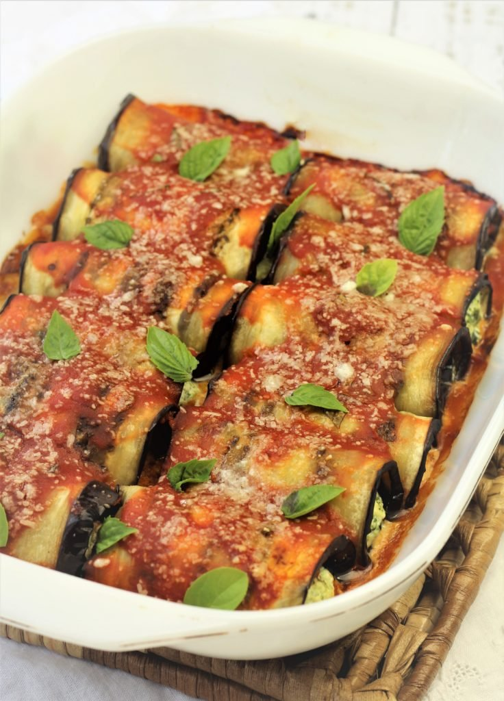 baked eggplant involtini with basil leaves on top