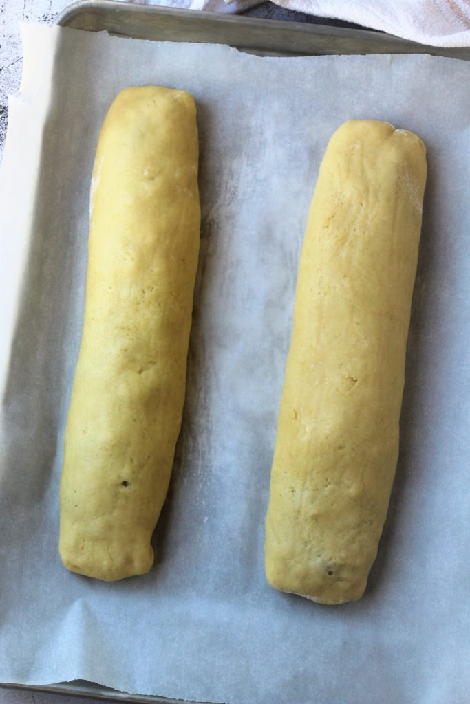 rolled cookie logs on baking sheet