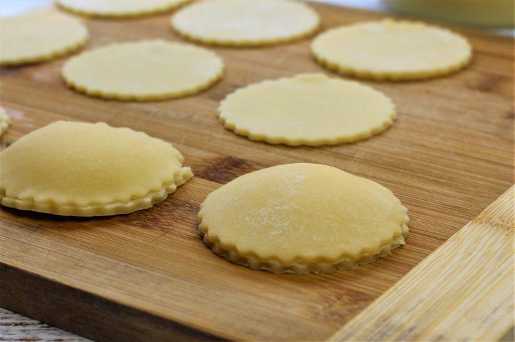 genovesi cookies resting on wood board
