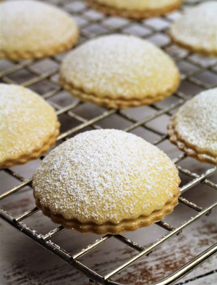 baked Genovesi Ericine dusted with powdered sugar on wire rack
