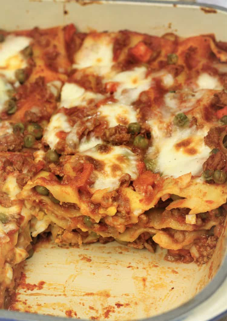 sicilian lasagna in pan with slice removed